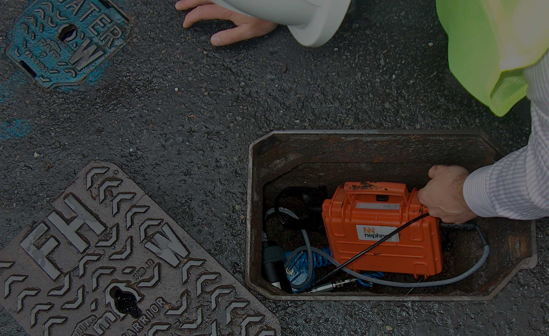 Nephnet-in-manhole-with-black-overlay1