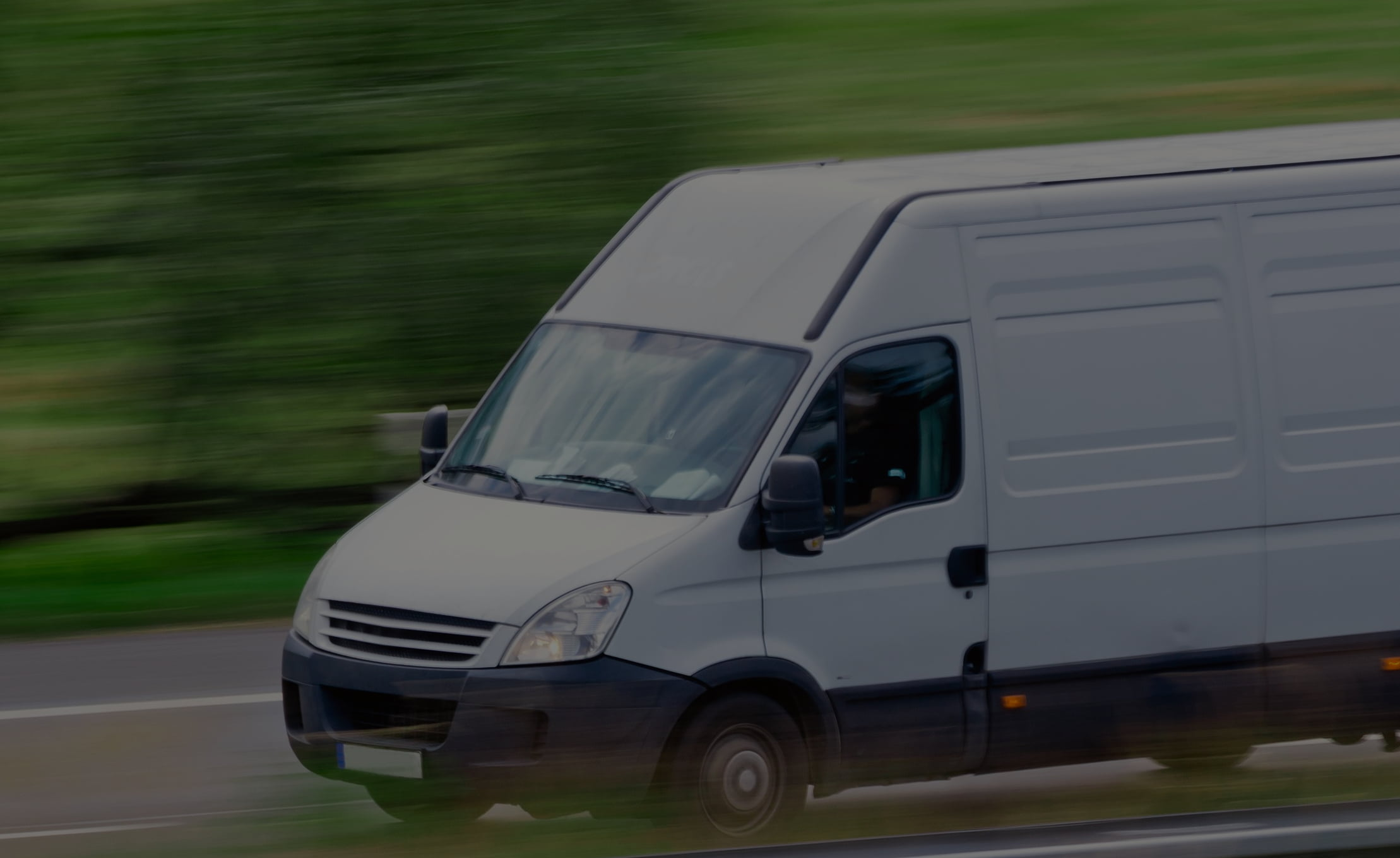 White-Van-Moving-Fast-with-black-overlay