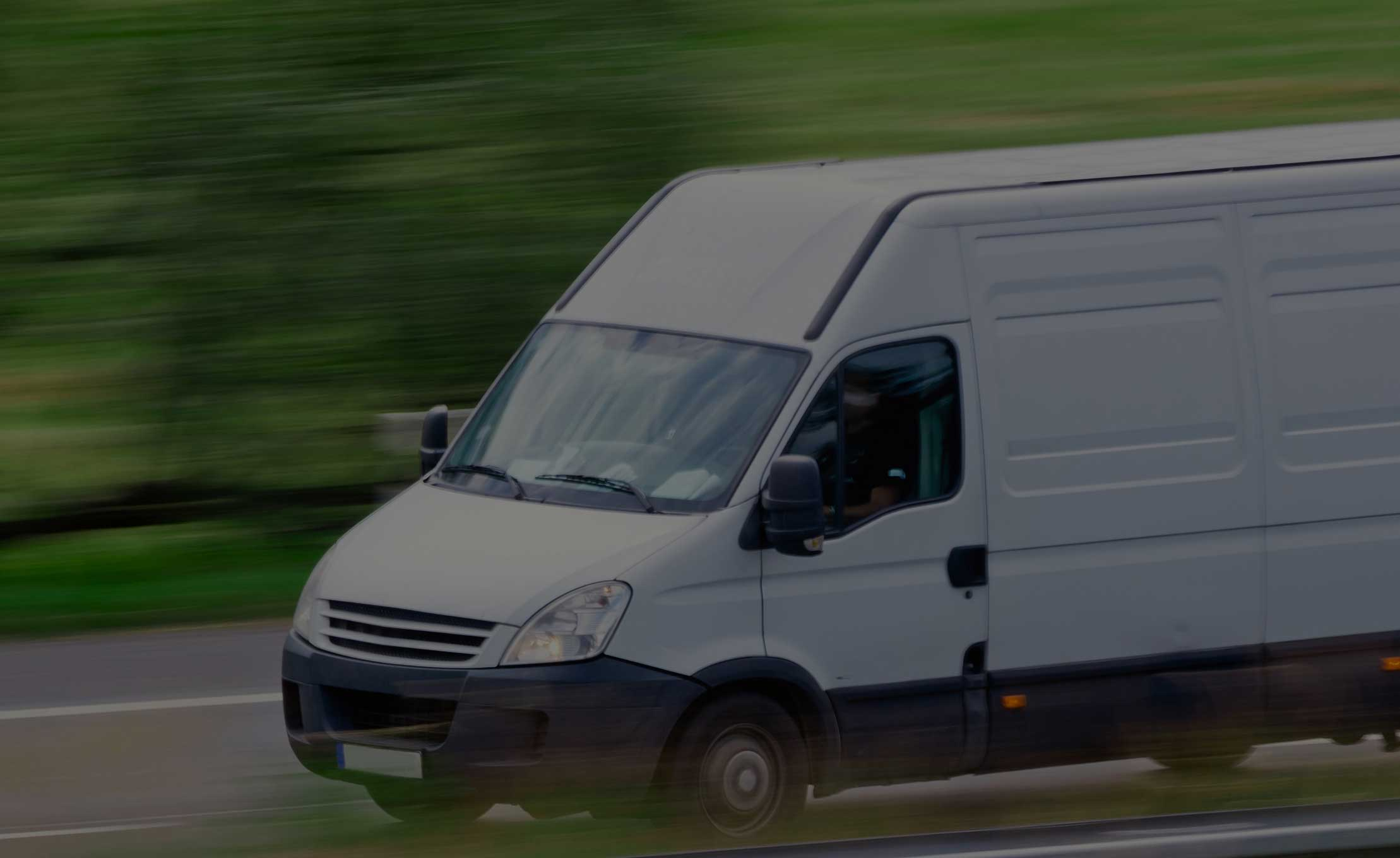 White-Van-Moving-Fast-with-black-overlay1